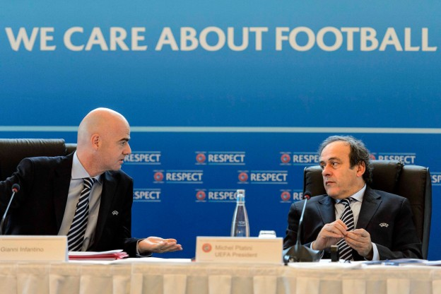 UEFA President Michel Platini, right, and UEFA General Secretary Gianni Infantino, left, open the last Union of European Football Associations, UEFA, executive board's meeting of the year, in Lausanne, Switzerland, Thursday, Dec.  6, 2012. (AP Photo/Keystone/Laurent Gillieron)