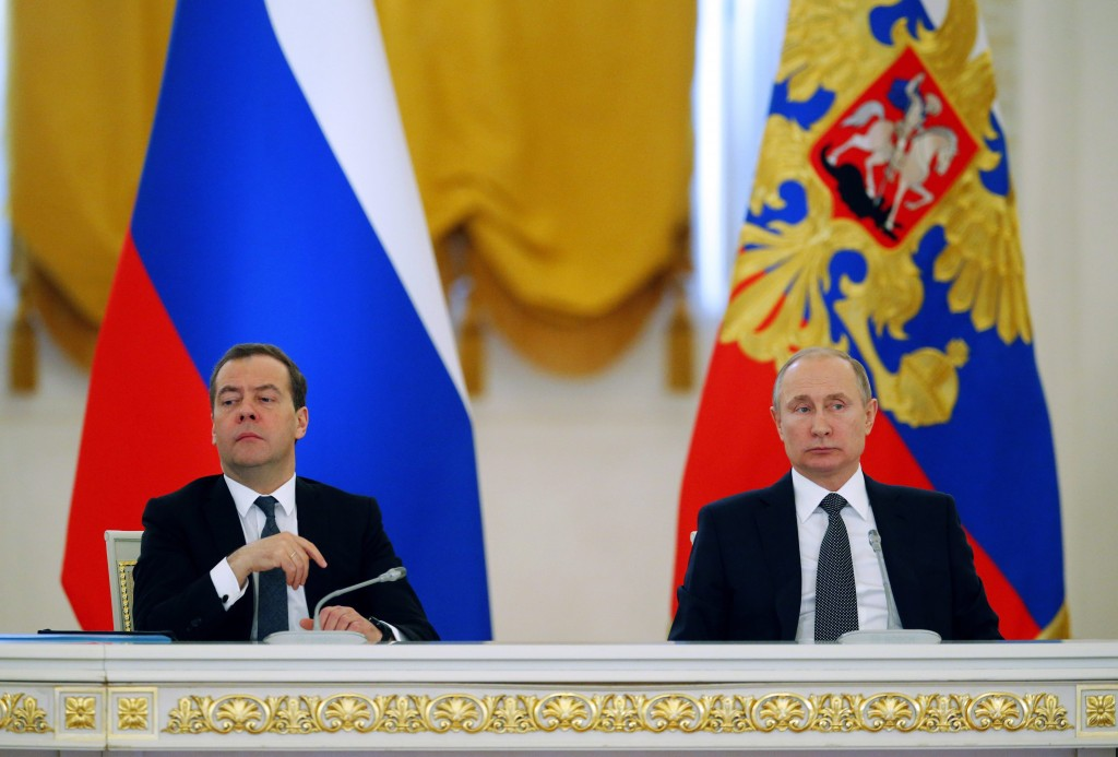 Russian President Vladimir Putin, right, and Russian Prime Minister Dmitry Medvedev attend a meeting of the State Council in the Kremlin, in Moscow, Russia. AP